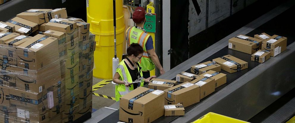 PHOTO: In this Feb. 9, 2018, file photo, packages move down a conveyor system to the proper shipping area at the new Amazon Fulfillment Center in Sacramento, Calif.