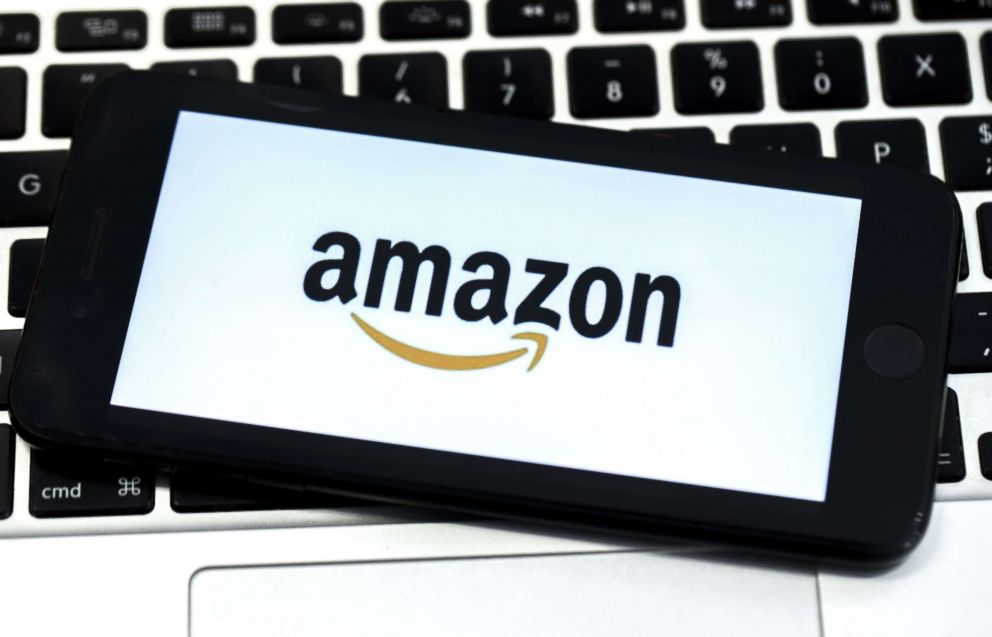 PHOTO: The Amazon logo is displayed on screen of a mobile photo in a stock photo.