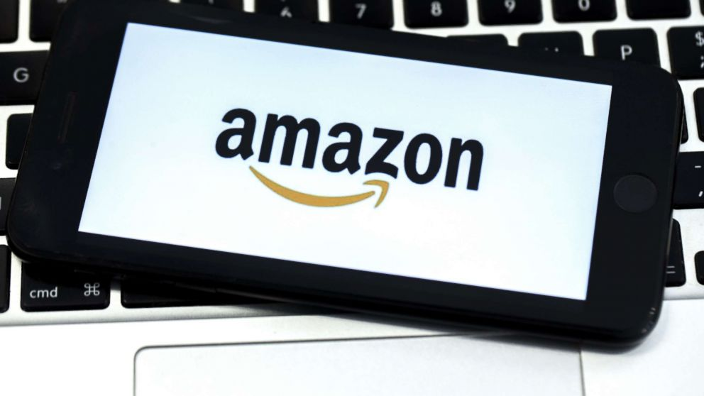 The Amazon logo is displayed on screen of a mobile photo in a stock photo.