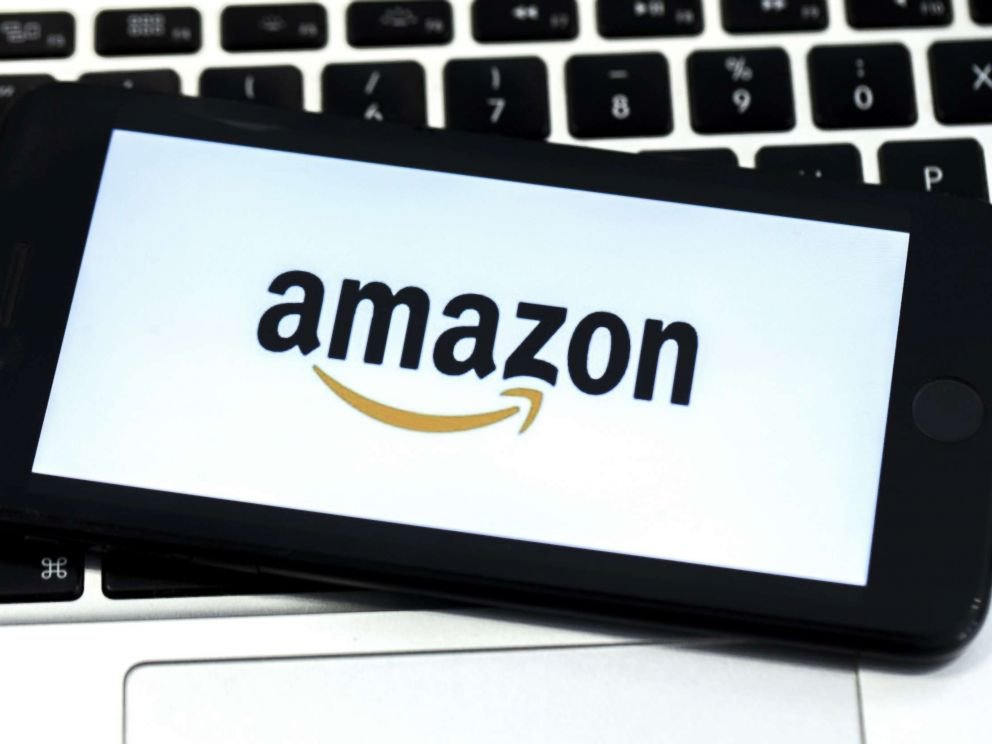 STOCK  Getty Images The Amazon logo is displayed on screen of a mobile