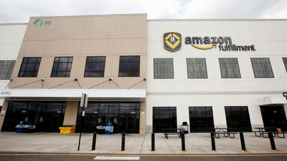 Signage for Amazon is displayed atop the company's fulfillment center in Robbinsville, N.J., June 7, 2018.
