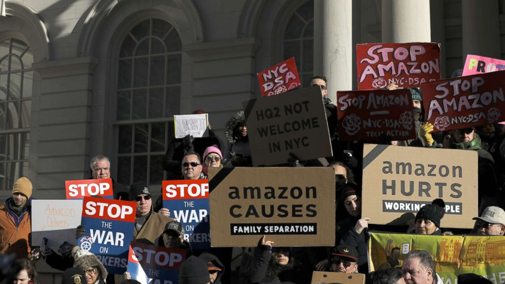 Protestors rally against Amazon and the company's plans to move their second headquarters to the Long Island City neighborhood of Queens, at New York City Hall, Jan. 30, 2019.