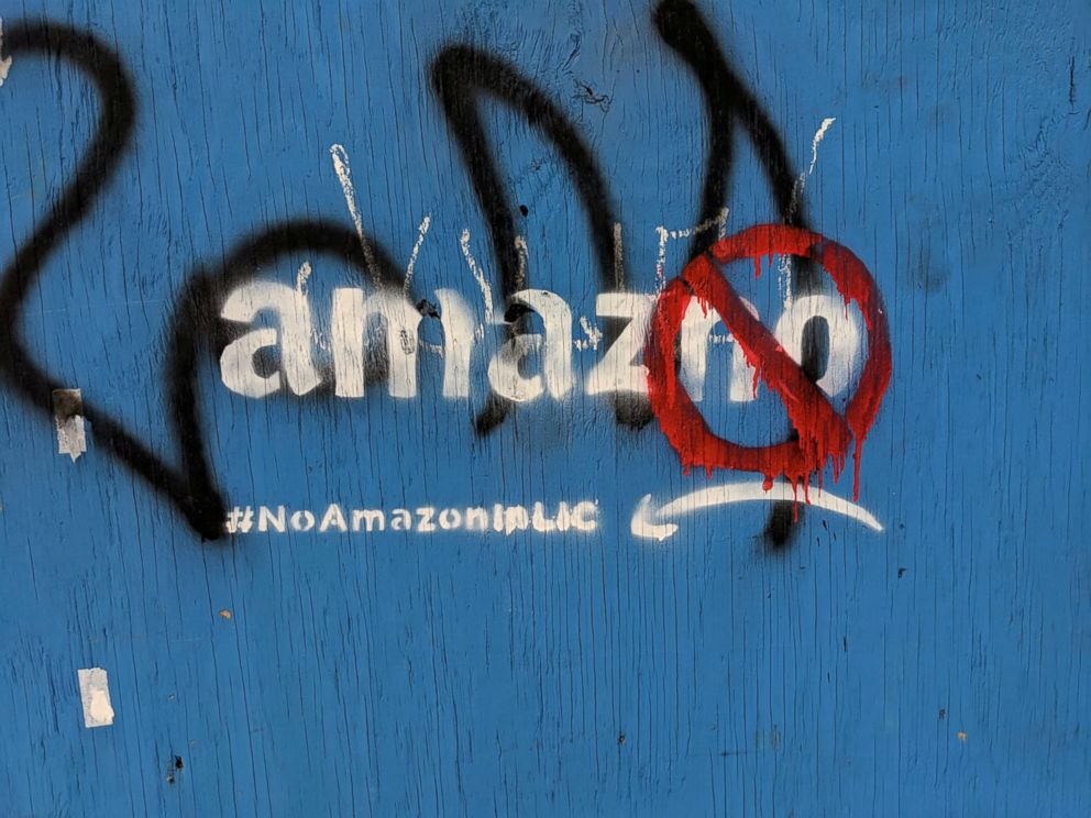 PHOTO: Graffiti opposing the construction of the new Amazon campus covers a fence at a vacant lot in the Long Island City neighborhood of New York, Dec. 5, 2018.