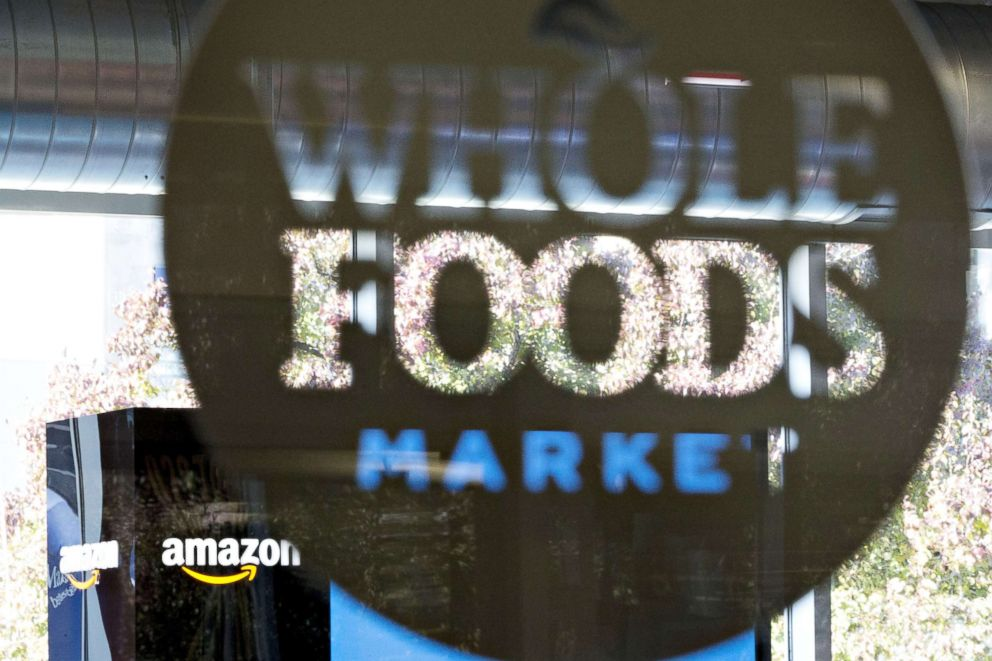 PHOTO: Amazon.com Inc. signage is displayed at a Pop-Up store inside the Lakeview Whole Foods Market Inc. store in Chicago, Illi, on Nov. 20, 2017.