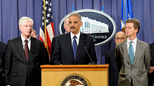 PHOTO: Attorney General Eric Holder, center, accompanied by Housing and Urban Development (HUD) Secretary Shaun Donovan, right, Iowa Attorney General Tom Miller, and other federal and state officials announces a settlement regarding mortgage loan servicin