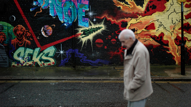 PHOTO: A man walks past street art in east London on Dec. 20, 2012 as the clock is ticking down to Dec. 21, the supposed end of the Mayan calendar, and from China to California to Mexico, thousands are getting ready for what they think is going to be a fa