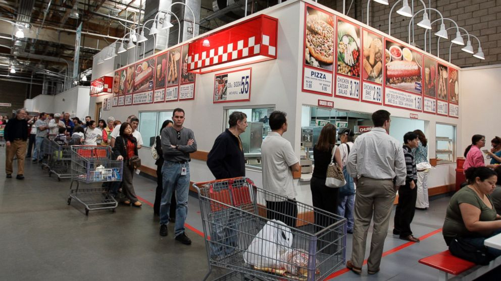 Costco warehouse customers wait in a long line during lunchtime for hot dogs, pizza, and drinks at a Costco store in Mountain View, Calif. on March 6, 2007.