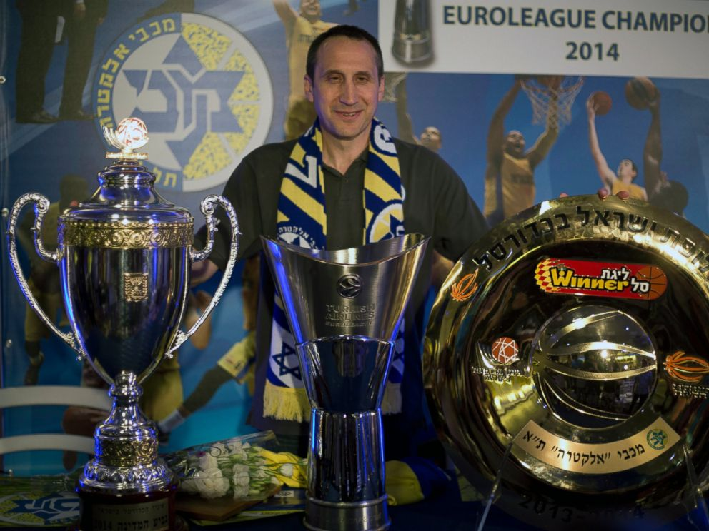 PHOTO: Maccabi Tel Avivs head coach David Blatt poses with the Israeli cup, European club champions cup and the Israeli club champions trophy in Tel Aviv, Israel, June 12, 2014.