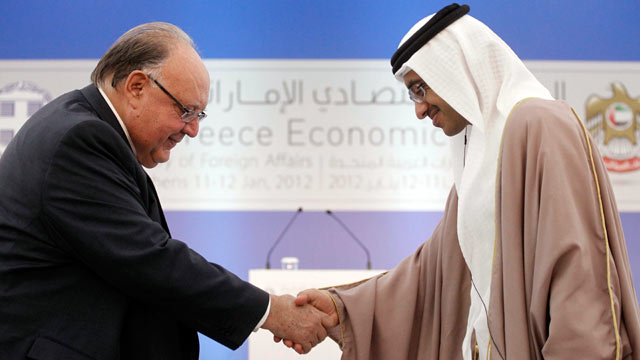 PHOTO: United Arab Emirates Foreign Minister Sheikh Abdullah bin Zayed Al Nahyan, right, shakes hands with Greek Deputy Prime Minister Theodoros Pangalos during a business forum on Jan.11, 2012.