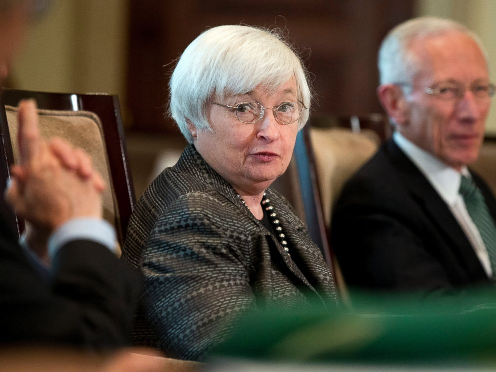 PHOTO: Federal Reserve Chair Janet Yellen, from left, with Vice Chairman Stanley Fischer, and the board of governors of the Federal Reserve System, presides over a meeting in Washington on July 20, 2015.