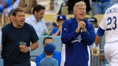 PHOTO: Los Angeles Dodgers owners Todd Boehly and Mark Walter cheer for Dodger Adrian Gonzalez during a baseball game against the St. Louis Cardinals, May 25, 2013, in Los Angeles.