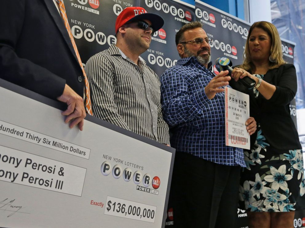 PHOTO: Anthony Perosi, second from right, holding a copy of the winning power ball ticket and his son Anthony Perosi III, second from left, as New Yorks Lottery Yolanda Vega, right, presented a prize check, June 4, 2015, in New York.