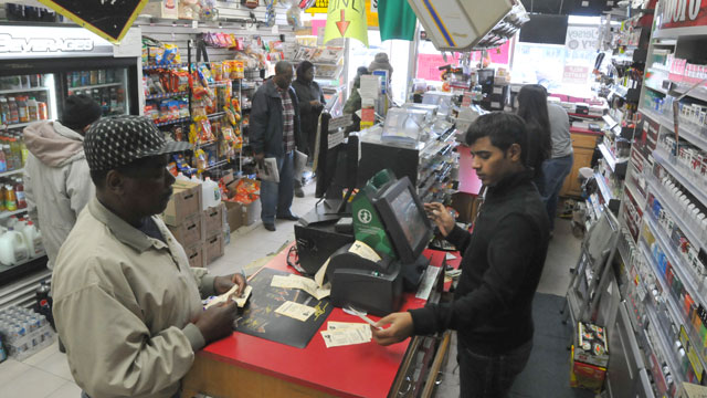 PHOTO: A customer purchases lottery tickets for the Powerball lottery at Foster Stationery in Bergenfield, N.J., Nov. 24, 2012.