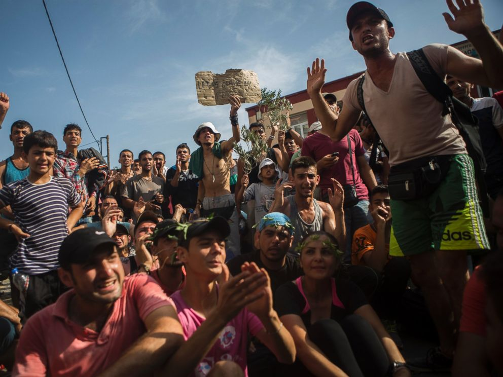 PHOTO: Refugees and migrants take part in a protest to demand faster processing by local authorities of their registration and the issuing of travel documents, at the port of Mytilene, on the northeastern Greek island of Lesbos, Sept. 7, 2015.
