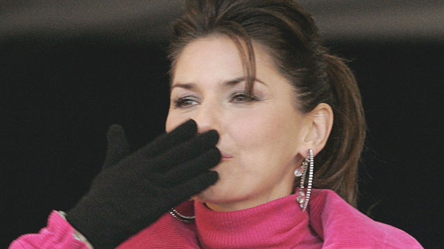 PHOTO:Canadian-born singer Shania Twain blows a kiss to the crowd as she leaves the stage Nov. 2, 2004, following a ribbon cutting at the official opening of the Shania Twain Centre in her home town of Timmins, Ontario. commitments.