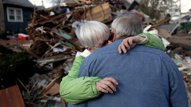 PHOTO: Sheila and Dominic Traina hug in front of their home which was demolished during Superstorm Sandy in Staten Island, N.Y., Nov. 2, 2012.