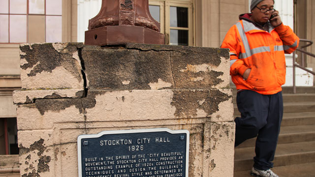 PHOTO: In this Feb. 29, 2012 photo, a Stockton city worker walks away from city hall in Stockton, Calif.