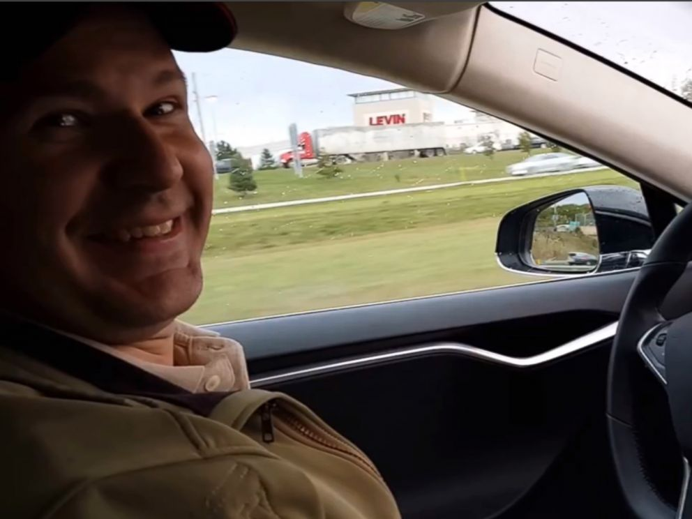 PHOTO: This still image taken from a video published on YouTube on Oct. 15, 2015, shows Joshua Brown of Canton, Ohio, in the drivers seat of his Tesla Model S while he demonstrates the cars self-driving mode.