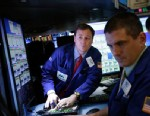 PHOTO: Traders work on the floor at the New York Stock Exchange in New York, Jan. 2, 2013.
