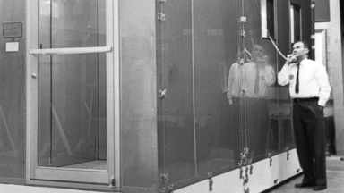 PHOTO: Willis Whitfield speaks by phone with someone inside an early model of the ultra-clean room he invented in 1962, in Albuquerque, N.M.
