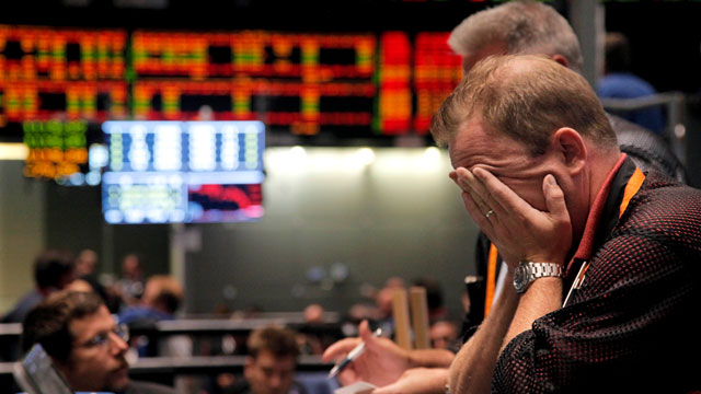 PHOTO: In this Aug. 8, 2011 file photo, trader Andrew Stavros reacts after the close of trading in the NASDAQ, 100 Index pit, on the floor of The CME Group in Chicago.