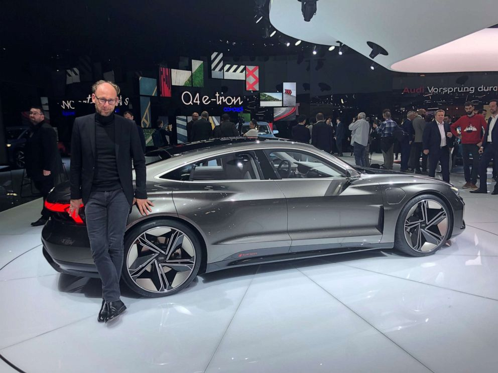 PHOTO: Marc Lichte, Audis head of design, posing next to the e-tron GT concept at the Geneva Motor Show.
