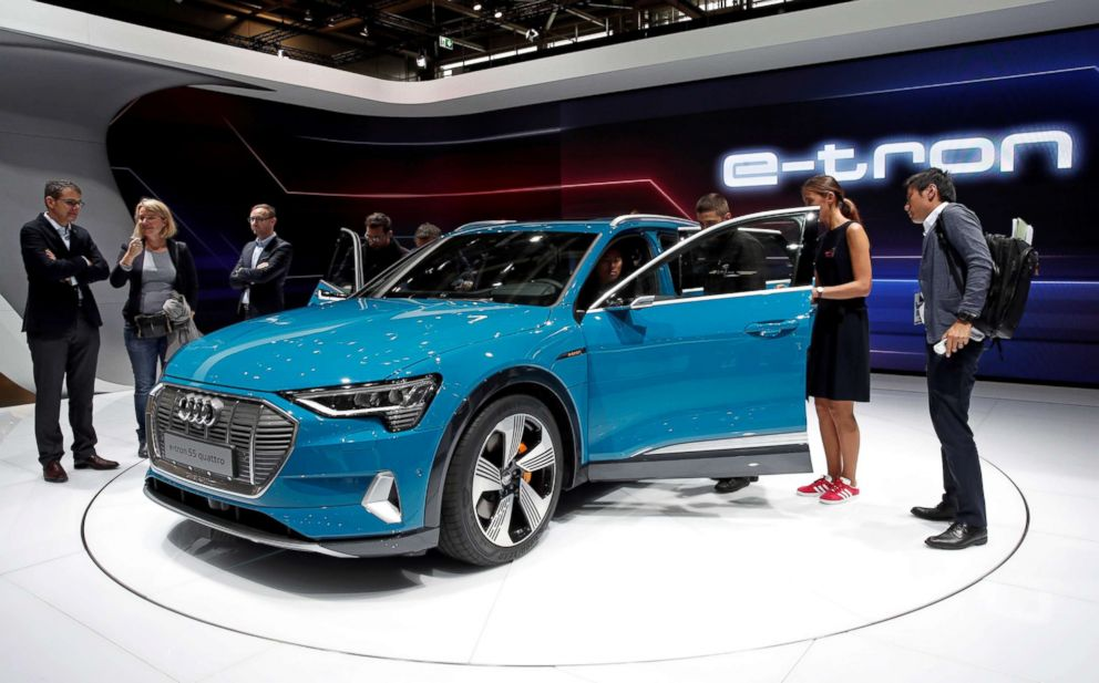 PHOTO: People inspect the Audi E-Tron 5S Quattro during the first press day at the Paris auto show in Paris, Oct. 2, 2018.