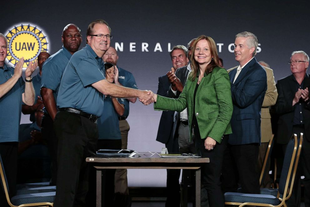 PHOTO: Mary Barra, Chairman and CEO of General Motors Co. and Gary Jones, president of the United Auto Workers, shake hands during a GM event at the Renaissance Center in Detroit, July 16, 2019.