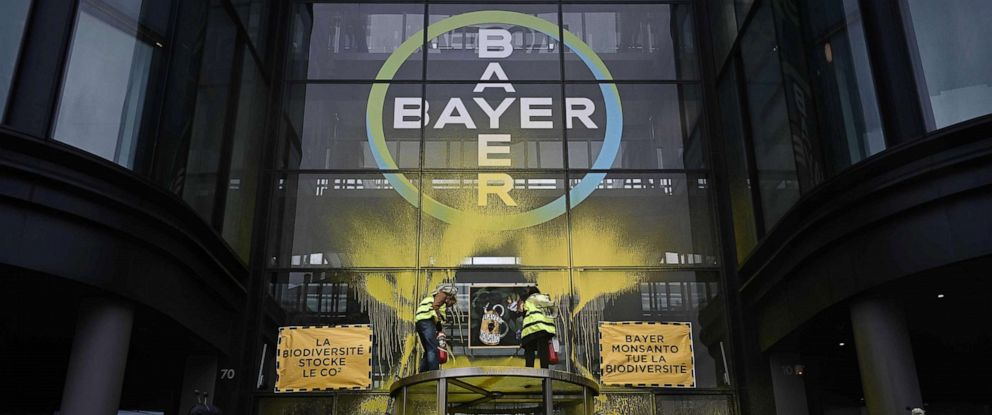 PHOTO: Activists protest at the offices of Bayer on the outskirts of Paris, March 14, 2019.