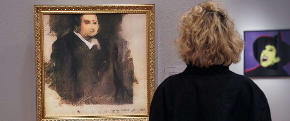 "PHOTO: A woman looks at a work of art created by an algorithm by a French collective named OBVIOUS which produces art using artificial intelligence, titled ""Portrait of Edmond de Belamy,"" at Christies in New York, Oct. 22, 2018."