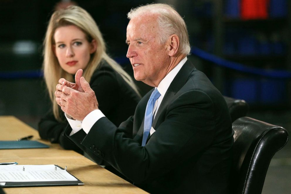 PHOTO: Vice President Joe Biden, right, speaks as Elizabeth Holmes, founder and CEO of Theranos, left, listens during a visit to Theranos manufacturing in Newark, Calif., July 23, 2015.