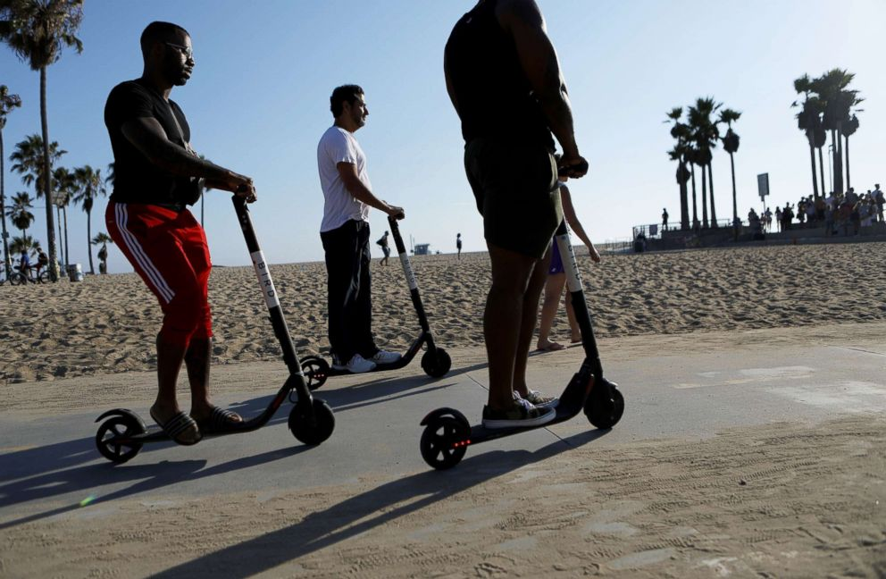 PHOTO: People ride Bird shared dockless electric scooters along Venice Beach, Aug. 13, 2018, in Los Angeles.