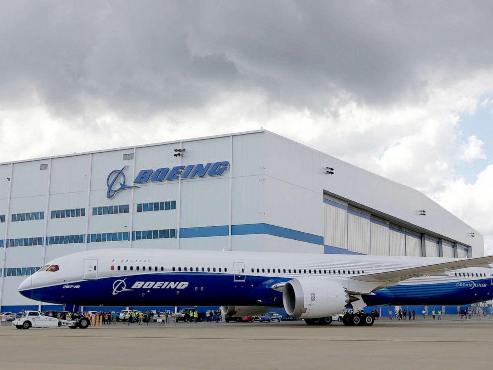 PHOTO: Boeing employees stand near the new Boeing 787-10 Dreamliner at the companys facility in South Carolina after conducting its first test flight at Charleston International Airport in North Charleston, S.C., March 31, 2017.