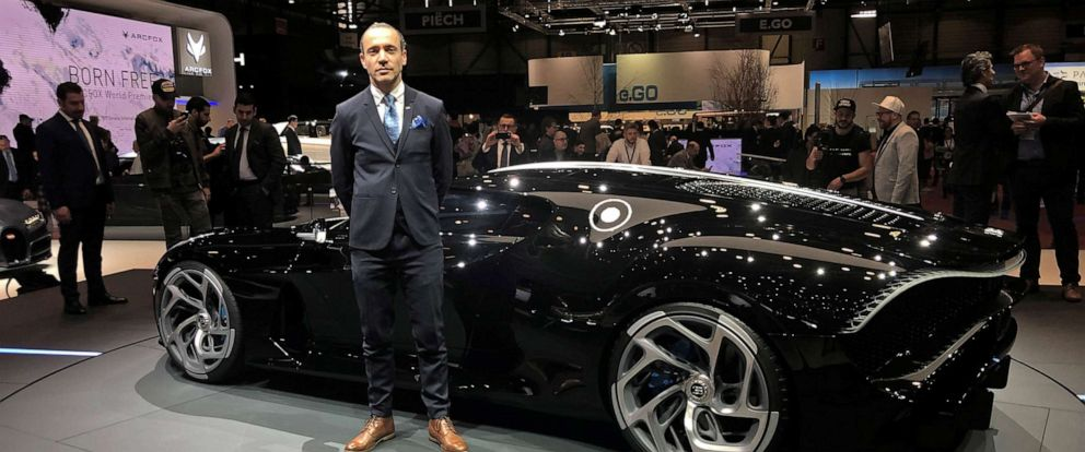 """PHOTO: Etienne Salome stands next to his creation, the Bugatti """"La Voiture Noire,"""" the Black Car, at the Geneva Motor Show, March 5, 2019."""