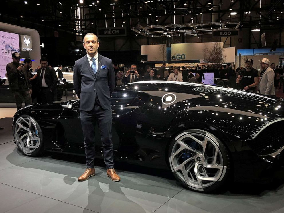 PHOTO: Etienne Salome stands next to his creation, the Bugatti La Voiture Noire, the Black Car, at the Geneva Motor Show, March 5, 2019.