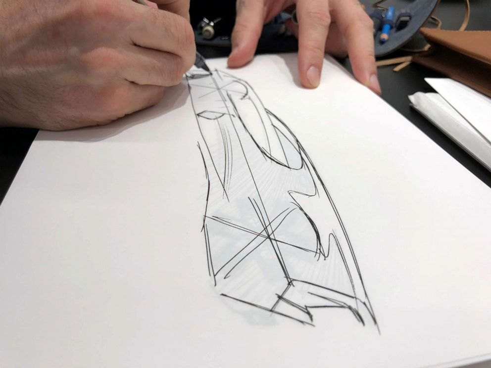 PHOTO: Etienne Salome doing what he loves most: sketching cars.