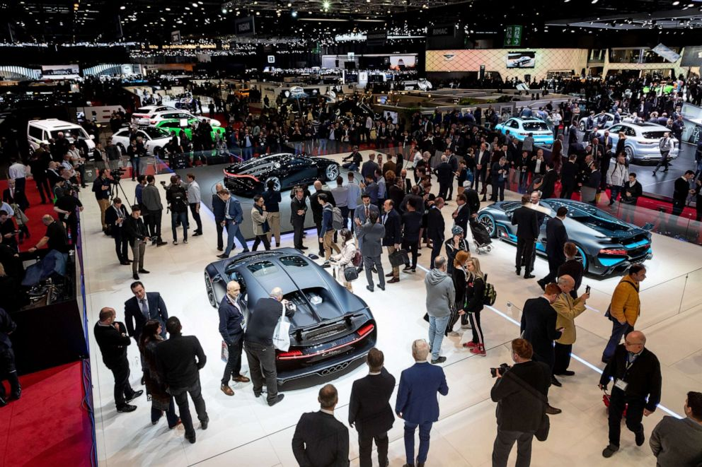 PHOTO: Bugatti cars are displayed on the floor of the Geneva Motor Show, March 5, 2019.