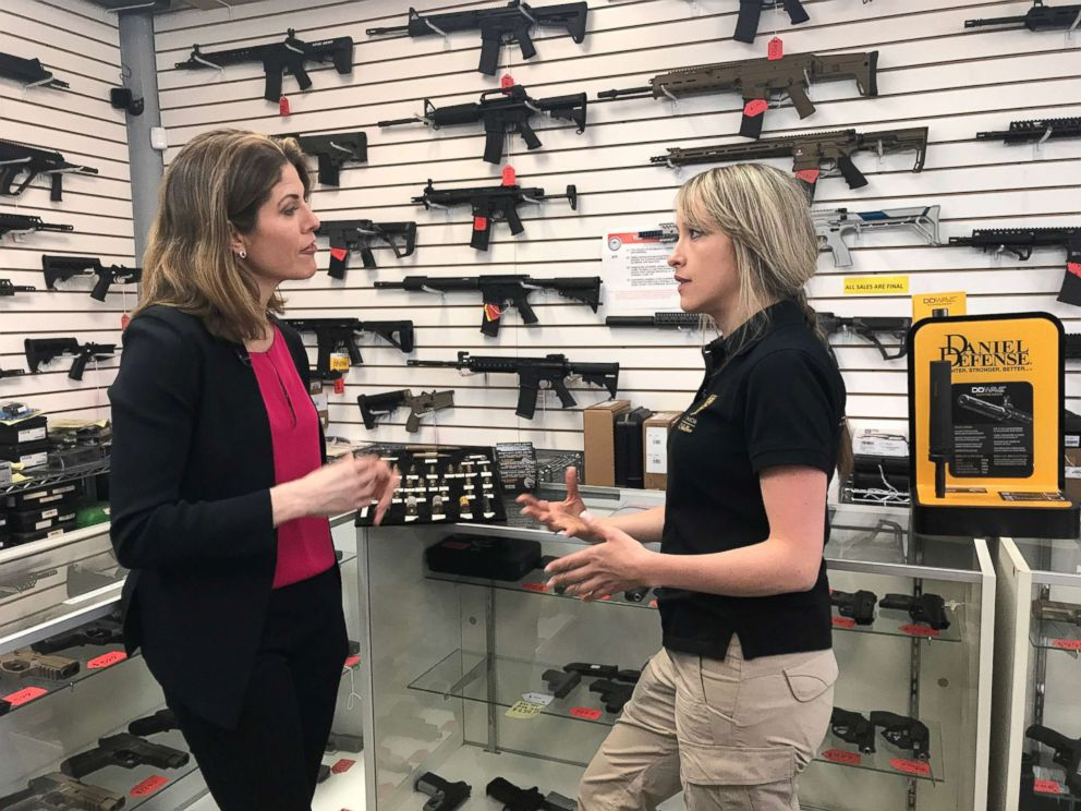 PHOTO: Gloria Riviera talks to MC Armor's Carolina Ballesteros in a gun shop.