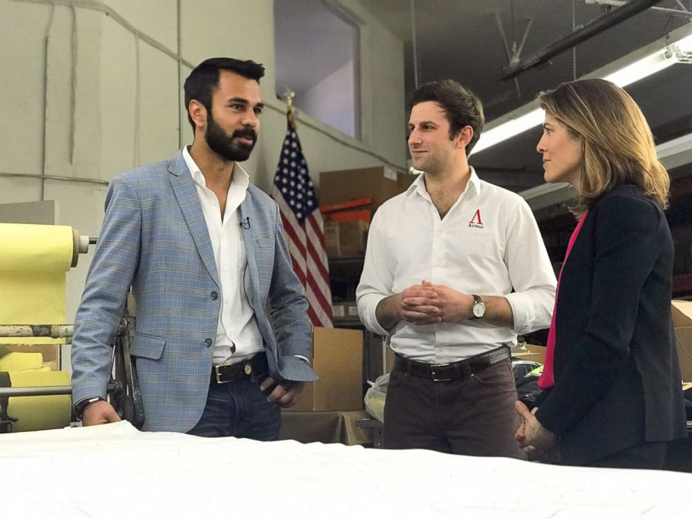 PHOTO: Aspetto Inc. CEO Abbas Haider and COO Robert Davis look at their company's suit patterns with Gloria Riviera.