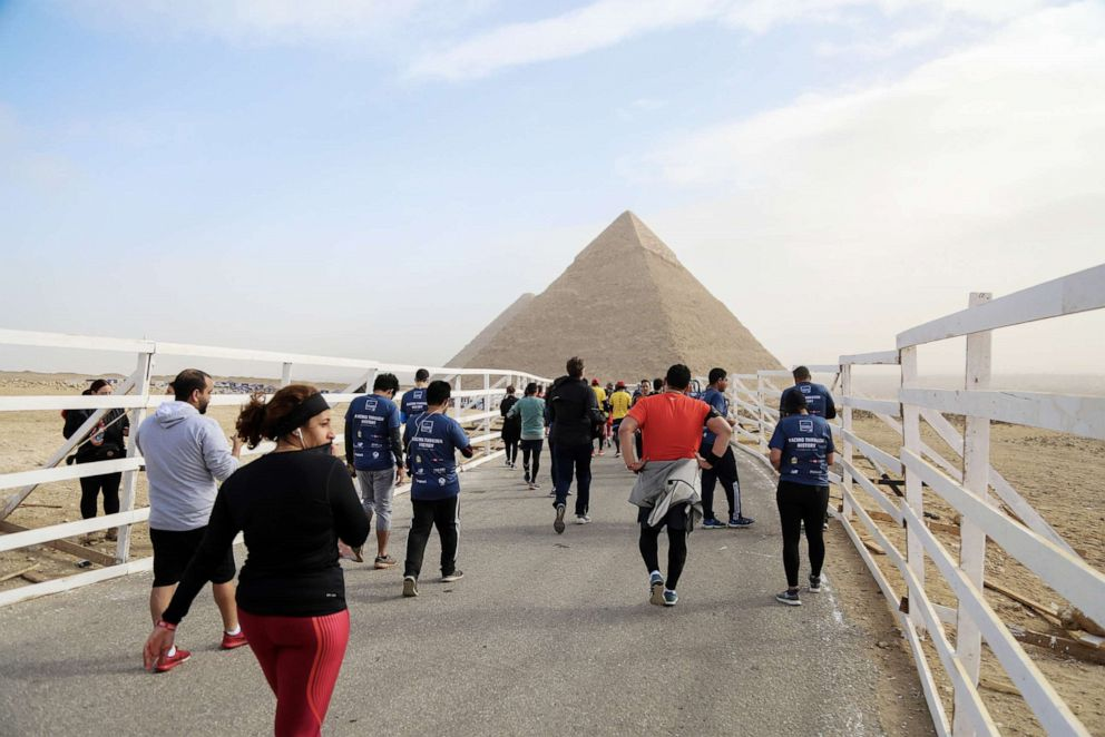 PHOTO: People gather around the Great Pyramid of Giza, which is located in the western part of capital city Cairo, in Egypt, Feb. 15, 2019.