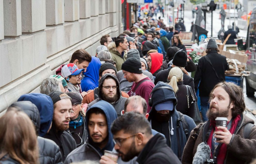 PHOTO: People wait in line to purchase legal cannabis products outside a government cannabis store in Montreal, Oct. 17, 2018.