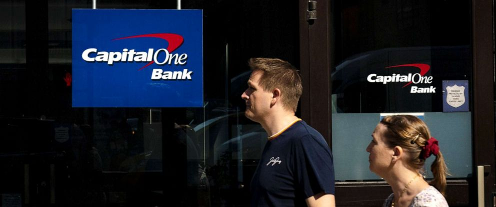 PHOTO: People walk past a Capital One bank in Midtown Manhattan on July 30, 2019, in New York City.
