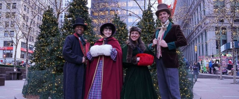 """PHOTO: Erick Carter, Mallory Hawks, Natalie Storrs and Topher Lengerich perform carols as the """"The Original Dickens Carolers."""""""
