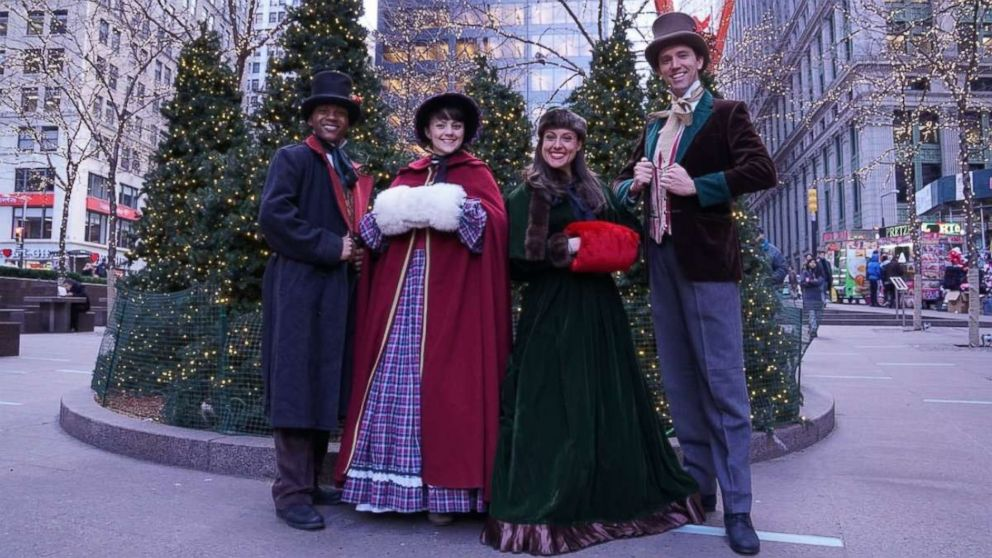 """Erick Carter, Mallory Hawks, Natalie Storrs and Topher Lengerich perform carols as the """"The Original Dickens Carolers."""""""