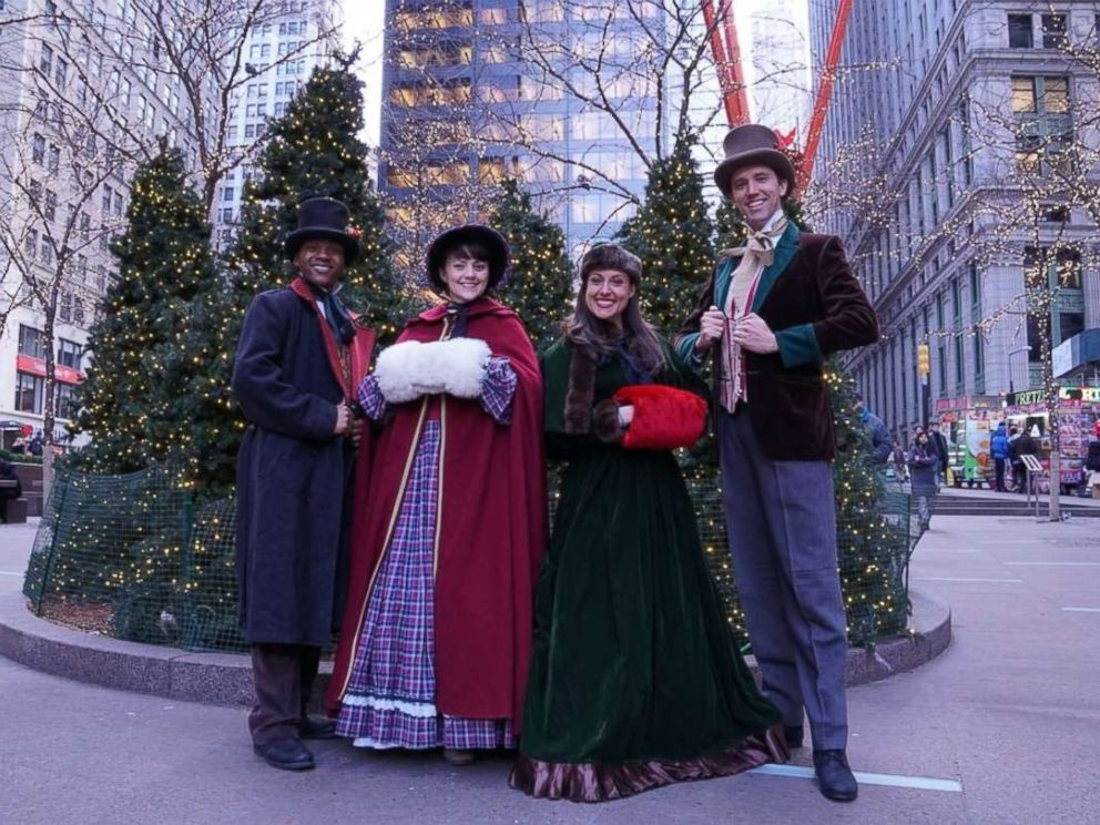 PHOTO: Erick Carter, Mallory Hawks, Natalie Storrs and Topher Lengerich perform carols as the The Original Dickens Carolers.