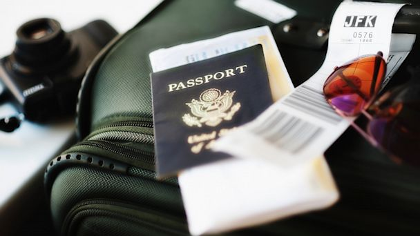 PHOTO: Passport and boarding pass on luggage