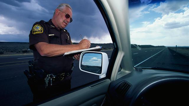 PHOTO: Sheriff writing a speeding ticket