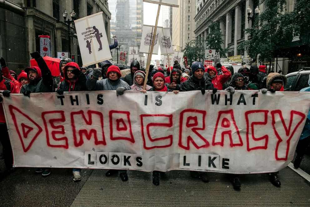 PHOTO: Braving snow and cold temperatures, thousands marched through the streets near City Hall during the 11th day of an ongoing teachers strike on Oct. 31, 2019 in Chicago.