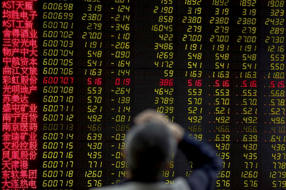 PHOTO: A man rubs his forehead as he monitors stock prices at a brokerage house in Beijing, Monday, May 13, 2019.