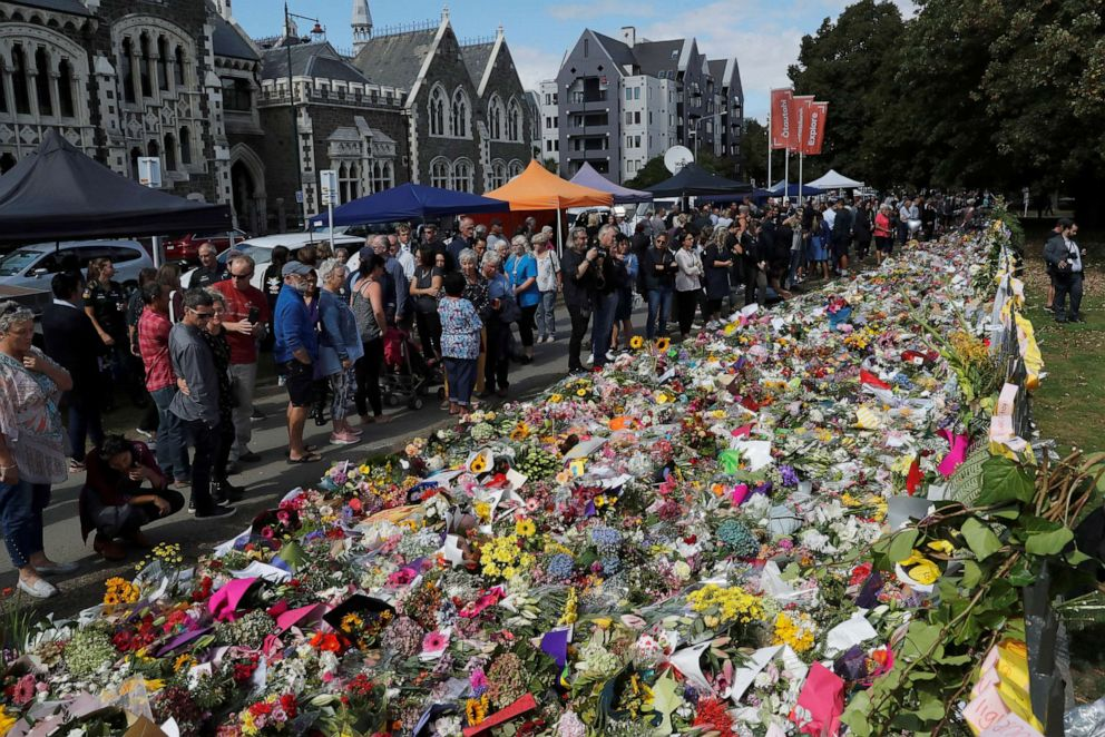 PHOTO: People visit a memorial site for victims of Fridays shooting, in front of Christchurch Botanic Gardens in Christchurch, New Zealand, March 19, 2019.